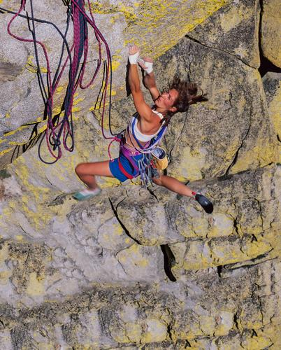 Female climber gripping the edge. Human being Youth (Young adults) Young woman 18 - 30 years Adults Power Success Rope Adventure Peak Fear of heights Climbing