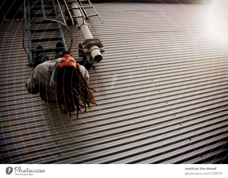 Just let it dangle! Wall (building) Facade Tin Waves Corrugated sheet iron Window Worm's-eye view Climbing Break Effort Clouds Alley Parallel Man Dark Cold