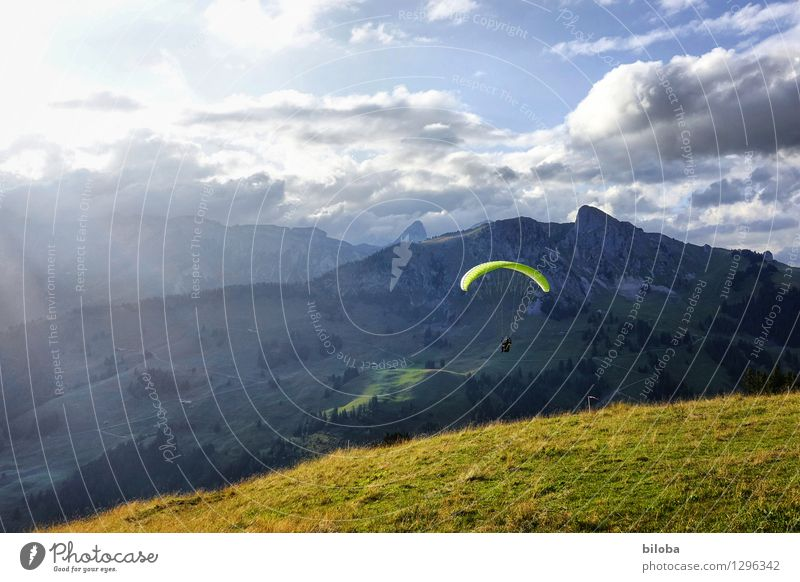 Paraglider takes off in a dreamlike evening atmosphere Paragliding Flying Gliding Hover Leisure and hobbies Vacation & Travel Freedom Mountain Hiking luck