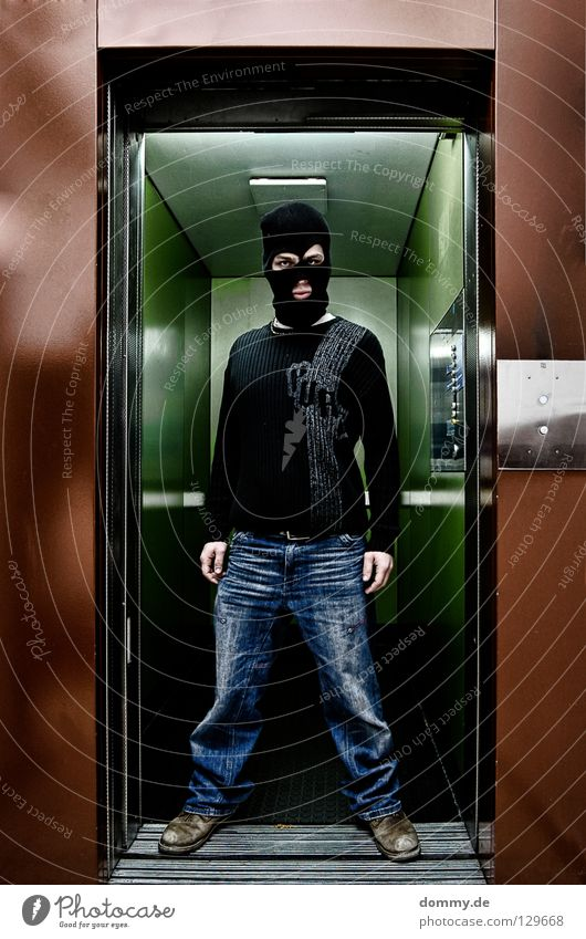 Welcome BLACKHEAD II Man Fellow House (Residential Structure) Building Elevator Driving Black Sweater Footwear Stand Brown Green Slit Criminal Thief Dangerous