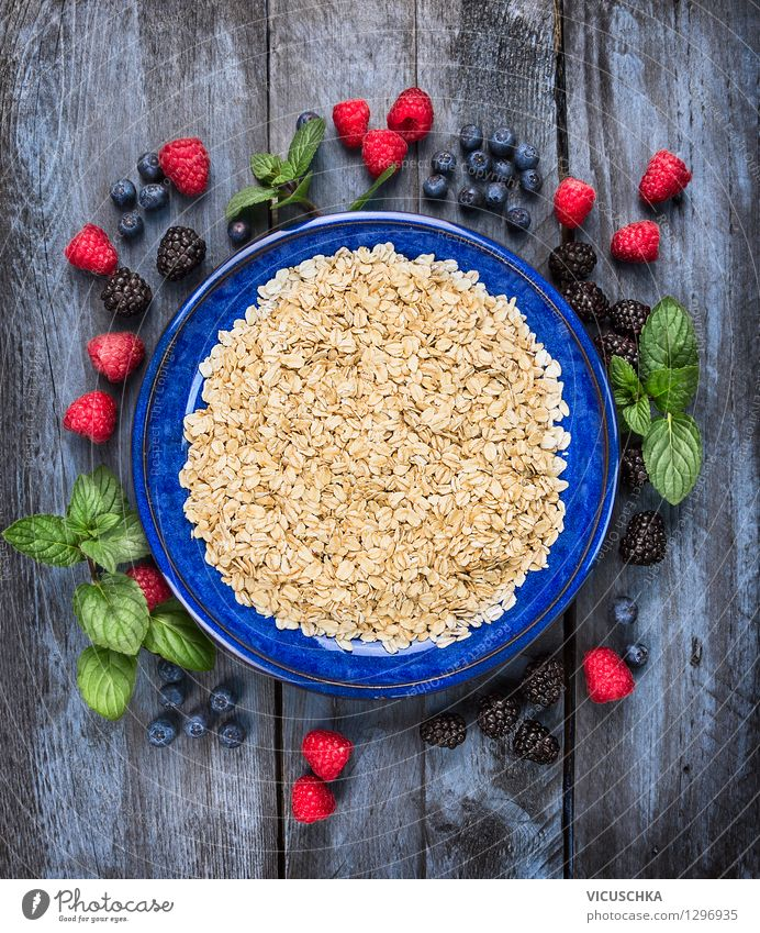 Oat flakes in blue bowl with berries Food Fruit Grain Nutrition Breakfast Organic produce Vegetarian diet Diet Plate Bowl Style Design Healthy Eating Life