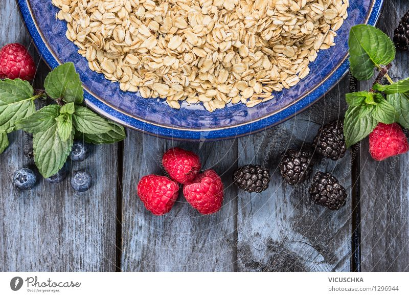 Oat flakes in blue bowl with berries Food Fruit Grain Nutrition Breakfast Organic produce Vegetarian diet Diet Plate Bowl Style Design Healthy Eating Life Table