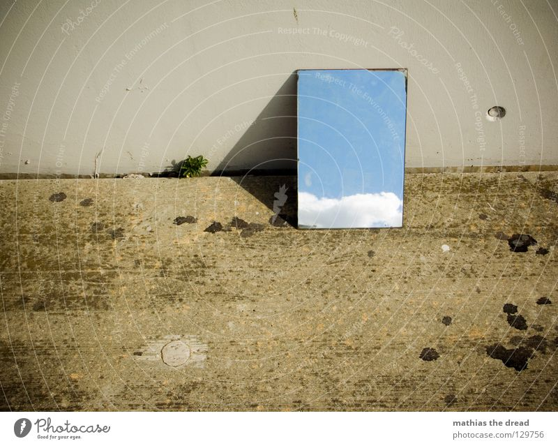BLUE IN THE SKY Mirror Mirror image Reflection Wall (building) Facade Cold Asphalt Dark Corner Grief Loneliness Gloomy Clouds Hope Beautiful Physics Reaction