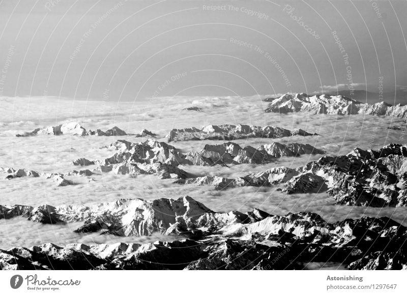 Sky Nature White Landscape Clouds Far-off places Black Mountain Environment Snow Bright Rock Horizon Weather Fog Vantage point