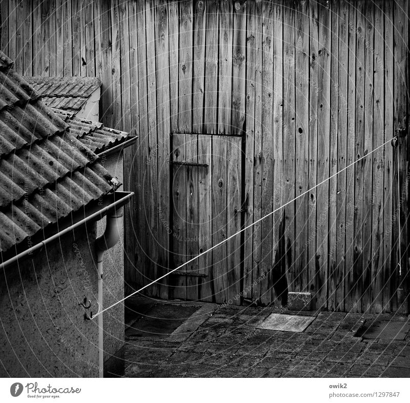 house and courtyard Building Barn Clothesline Wall (barrier) Wall (building) Facade Door Roof Roofing tile Wood Old Dark Sharp-edged Simple Firm Historic