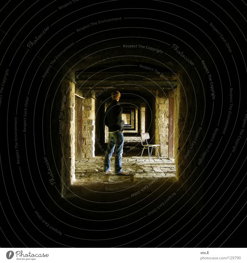 [i_] Fellow Man Masculine Posture Stand Dark Cellar Deep Light Far-off places Wall (barrier) Wall (building) Decline Historic Pattern Black Yellow Square