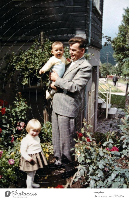 the father Father Child Family & Relations Sunday Happiness Flower Safety (feeling of) Suit Hair and hairstyles Old-school Sixties Seventies Siegerland Rose