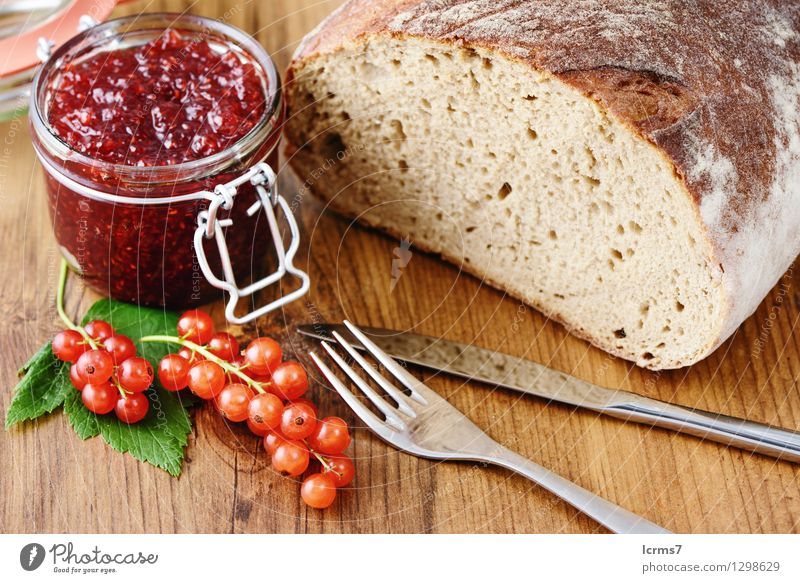 red currant jam and fresh bread Fruit Bread Jam Nutrition Breakfast Cutlery Knives Fork Eating currants bowl blue white table wood ribes rubrum food background