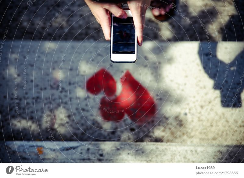 photographing hearts with smartphone mobile PDA Camera girl Young woman Youth (Young adults) by hand Fingers 1 Human being Heart 2 Stairs Shadow To hold on Love