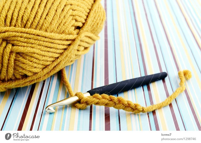 crocheting with brown wool. retro paper background. Design Leisure and hobbies Handcrafts Knit Utilize Captain Hook yarn handmade pattern Background picture