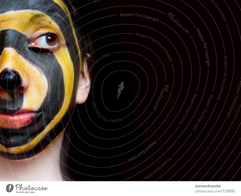 Mixed feelings Black Yellow Make-up Wearing makeup Spiral Sideways glance Portrait photograph Face Striped Apply make-up Youth (Young adults) Colour Mask Head