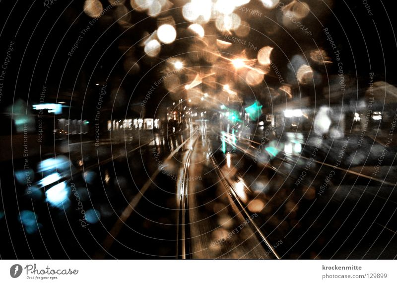 In the last tram Tram Transport Railroad tracks Drops of water Night Switzerland Town Night life Way out Late Dark Rain Wet Public transit ov Window pane Glass