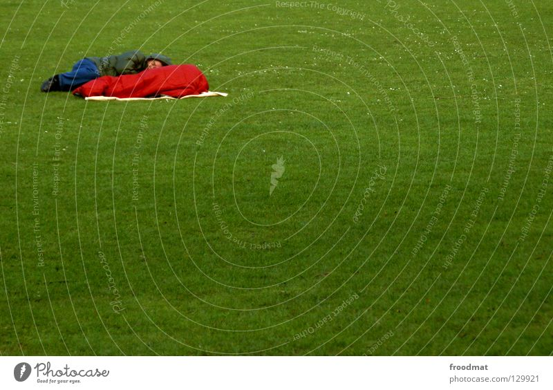 corner dormouse Meadow Grass Green Sleep Sleeping bag Tramp Relaxation Cold Spring Park Free space Places Left Duck down Red Patch of colour Minimal Tidy up