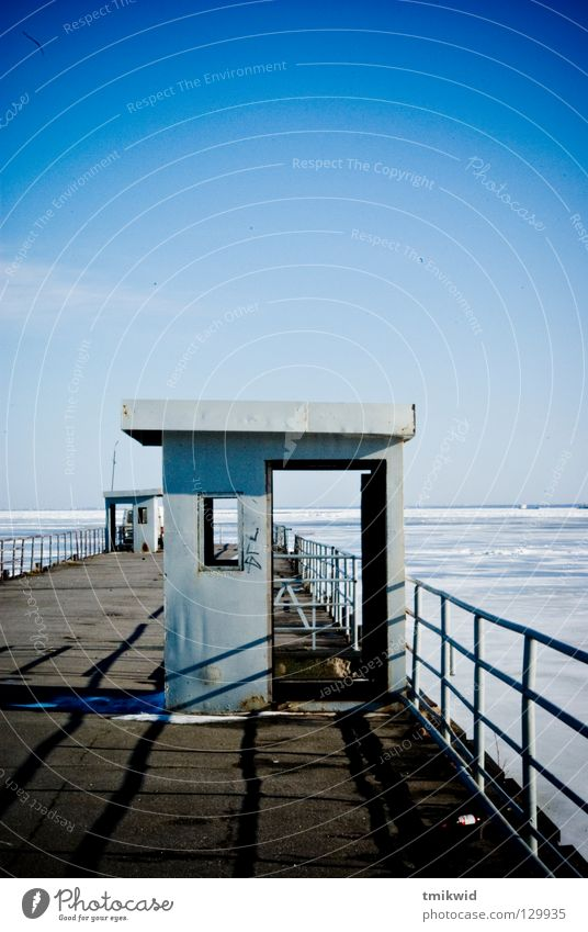 pier Jetty Express train Winter Sky Derelict blue sunny lonely sea lost