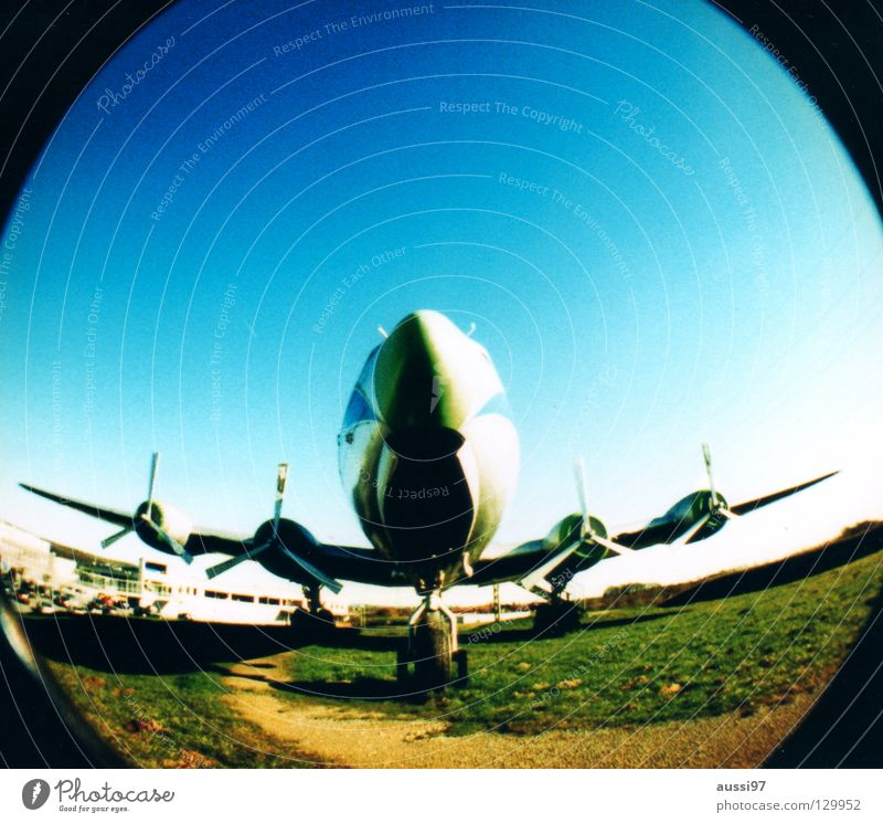 BLINDED BY THE FLIGHT Airplane Captain Engines Wing Airplane takeoff Fisheye Round Lomography Aviation Jet Airplane landing Sky kerosene Climate change
