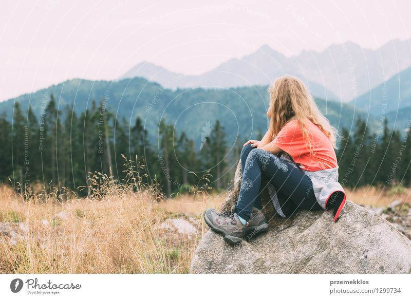 Girl is thougthful in the mountains Vacation & Travel Trip Summer Mountain Hiking Child 1 Human being 8 - 13 years Infancy Nature Landscape Grass Forest Rock