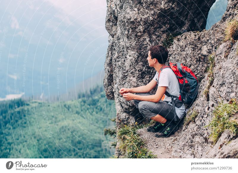 Boy sitting on the rocks in the mountains Human being Child Nature Vacation & Travel Youth (Young adults) Summer Landscape Young man Joy Mountain Boy (child)