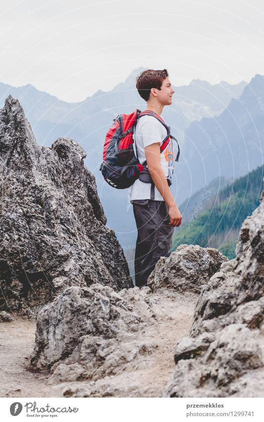 Boy standing on the rocks in the mountains Human being Child Nature Vacation & Travel Youth (Young adults) Summer Landscape Young man Joy Mountain Boy (child)