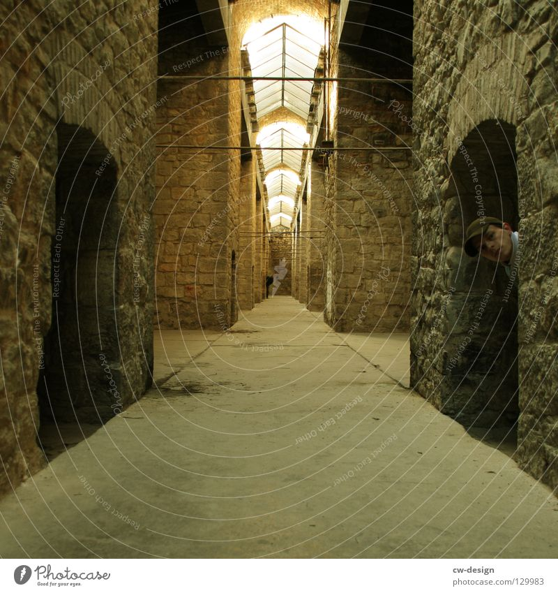 Historic Hide Corridor Hiding place Young man Masonry Arcade Skylight Vanishing point Stone wall Aberration Building line Man`s head Historic Buildings