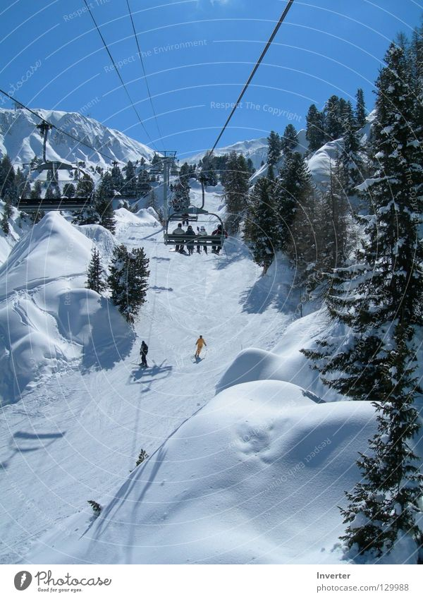 in the chairlift Vacation & Travel France White Human being Chair lift Cable car Mont Blanc Winter Snow Tall Weather Skiing Fir tree Ski lift Ski resort Ski run