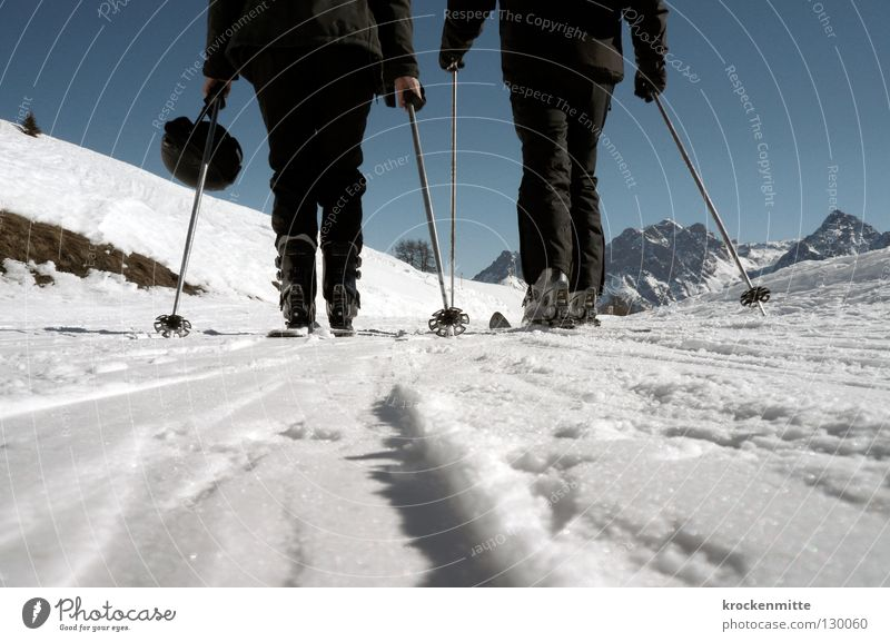 Human being White Winter Black Cold Snow Couple 2 Skiing In pairs Switzerland Tracks Skis Beautiful weather Effort Mountaineering