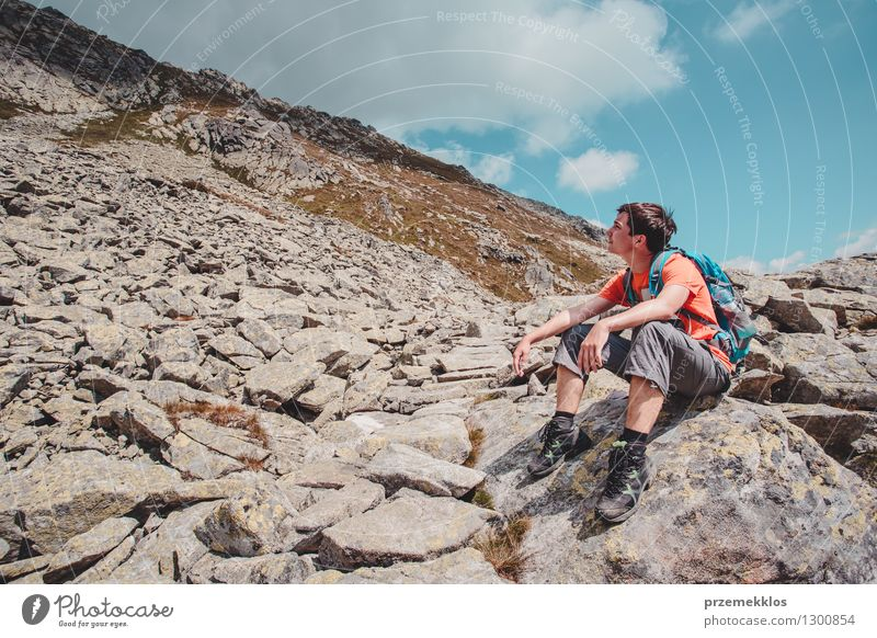 Boy resting on a rock in the mountains Human being Nature Vacation & Travel Youth (Young adults) Summer Landscape Young man Joy Mountain Boy (child) Freedom Lifestyle Rock Hiking 13 - 18 years Trip