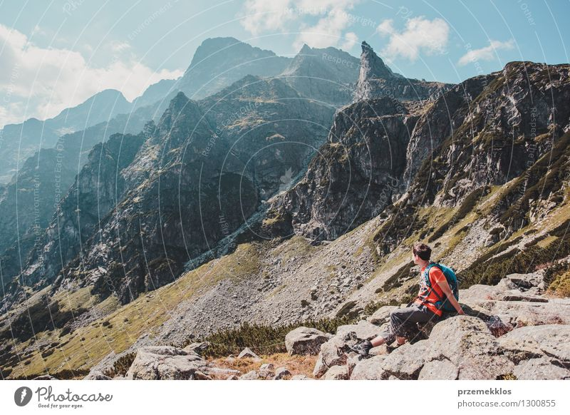 Boy resting on a rock in the Tatra Mountains Nature Vacation & Travel Youth (Young adults) Summer Boy (child) Freedom Lifestyle Rock Hiking 13 - 18 years Trip