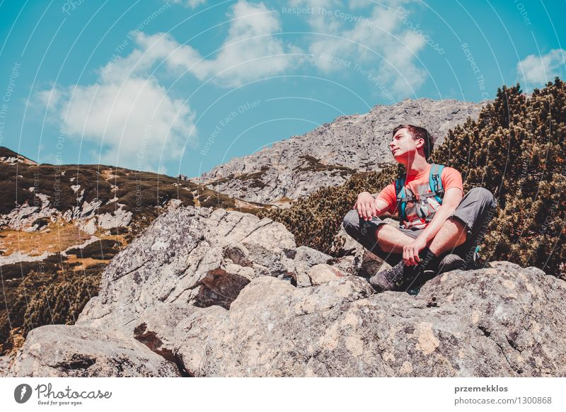 Boy resting on a rock in the mountains Human being Nature Vacation & Travel Youth (Young adults) Summer Joy Mountain Boy (child) Freedom Lifestyle Rock Power