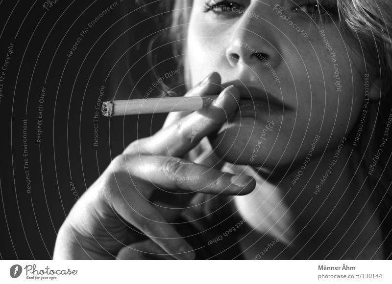 Woman Youth (Young adults) Dangerous Young woman Smoking To hold on Illness Smoke Burn Facial expression Cigarette Partially visible Danger of Life Face of a woman Embers Unhealthy
