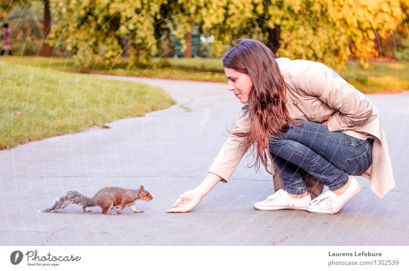 Girl and squirrel Human being Youth (Young adults) Beautiful Young woman Animal 18 - 30 years Adults Baby animal Yellow Warmth Feminine Funny Eating Playing