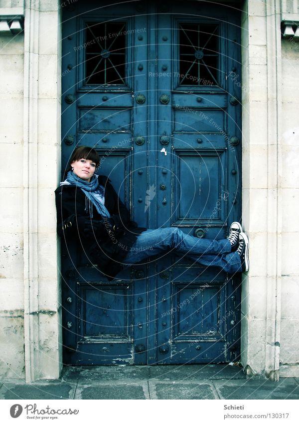 Relaxation deluxe Joy Contentment Woman Adults Gate Door Jeans Stone Sit Blue Paris France Easygoing Chucks Colour photo