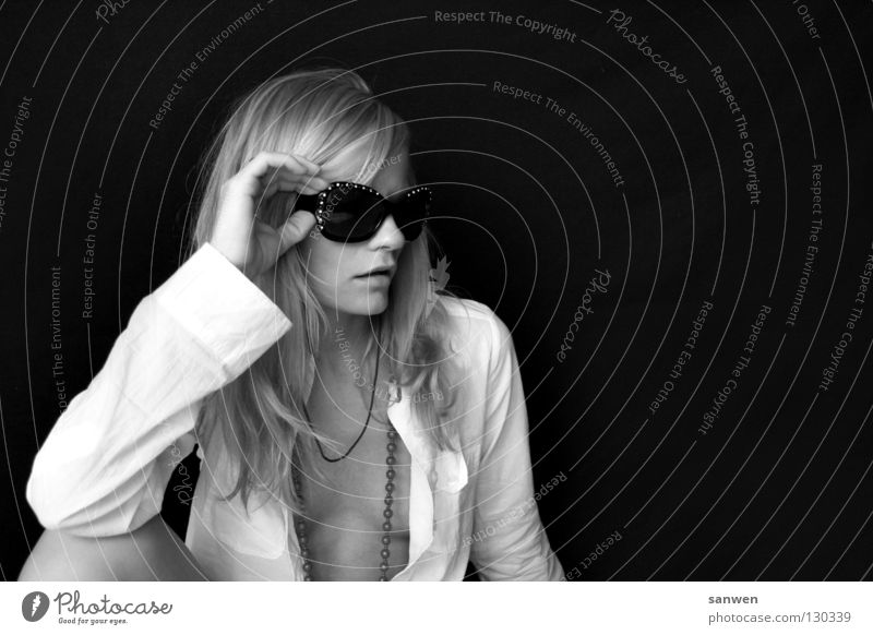 pessimistic Woman Blonde Long-haired Knee Joint Hand Low neckline Chin Background picture Dark Portrait photograph Sunglasses Easygoing Black & white photo