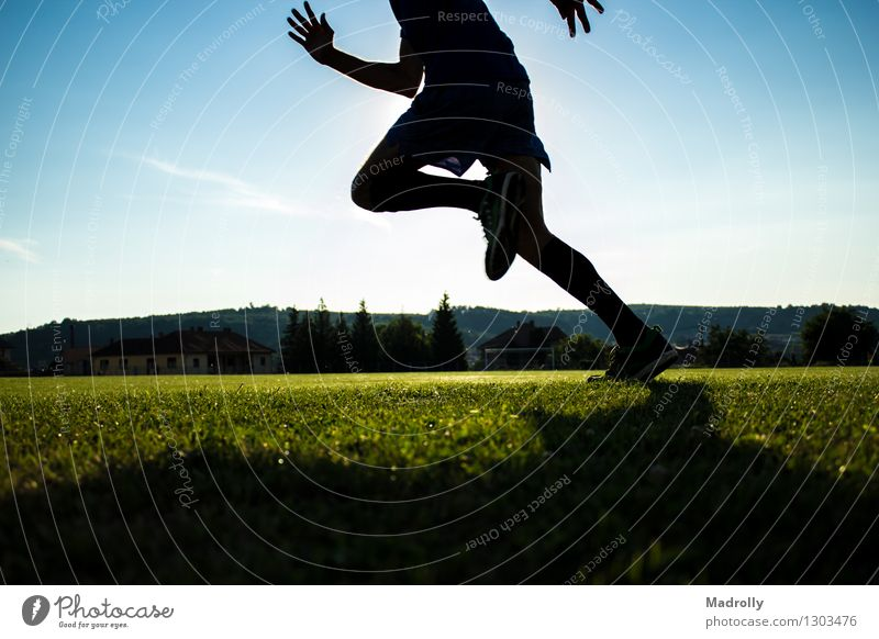 Runner training on a stadium Lifestyle Wellness Sun Sports Human being Man Adults Feet Sky Build Running Movement Speed Loneliness Energy Action athlete