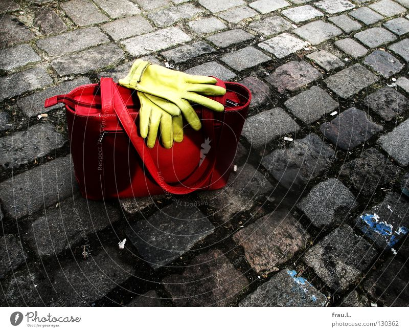 turned off Bag Gloves Red Green Leather Places Stand Posture Things Clothing Traffic infrastructure cobblestone pavement Street Lie Wait Leather bag