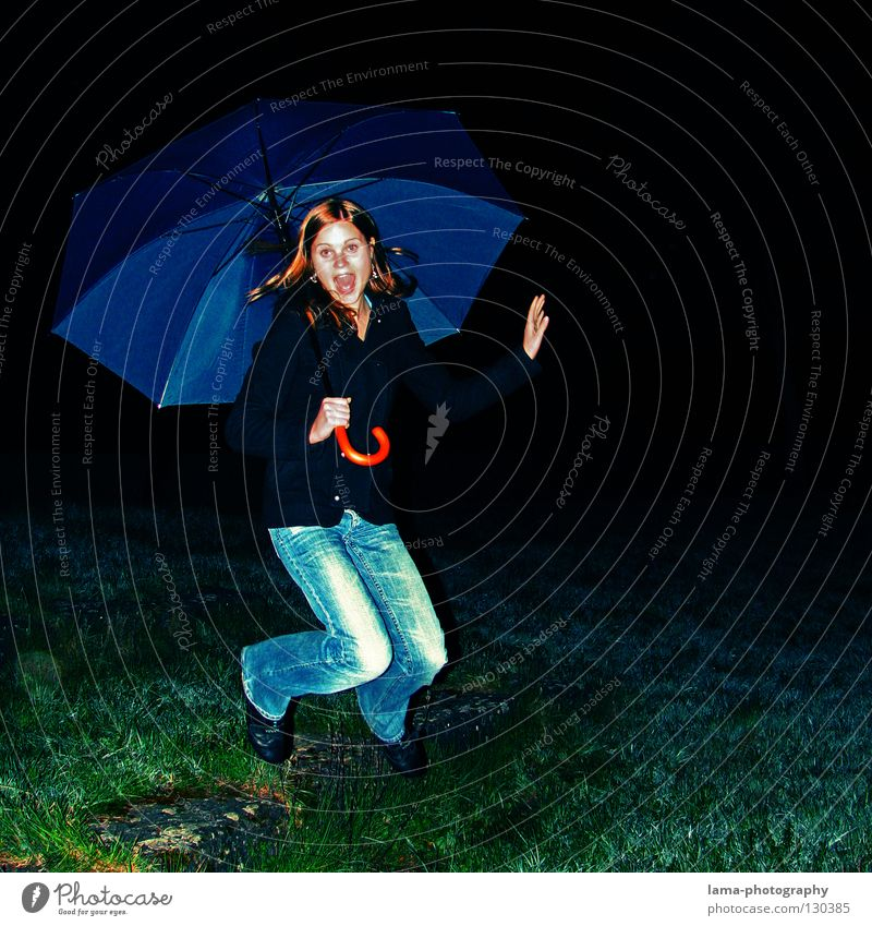 Woman Youth (Young adults) Joy Dark Meadow Jump Happy Laughter Rain Field Flying Action Umbrella Scream Grinning Hop
