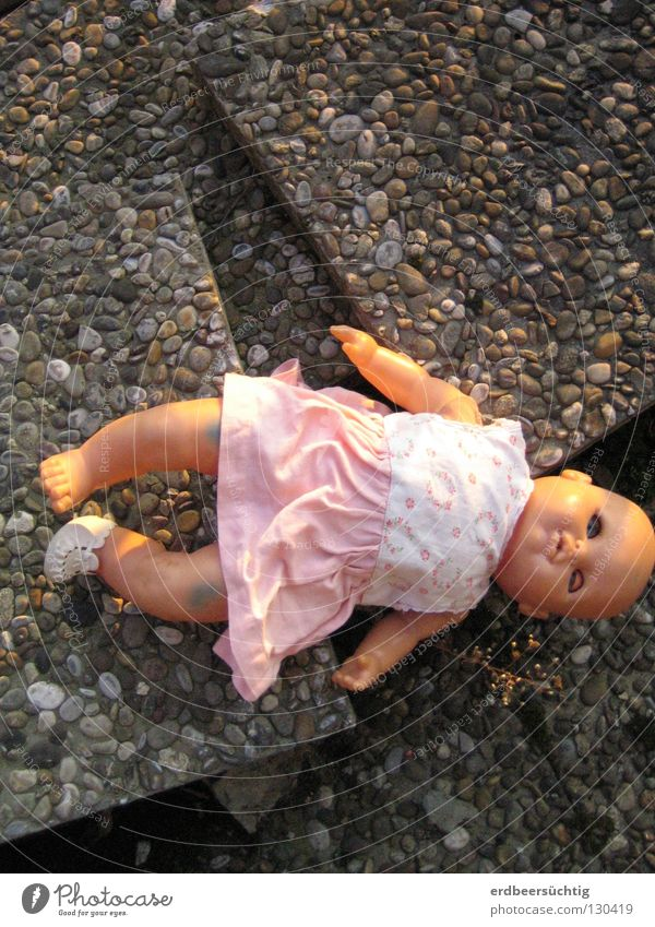 Lost childhood Infancy Dress Toys Doll Old Sadness Broken Grief Innocent Transience Time Baby doll Stone slab Doomed Past Former Search Colour photo Lie