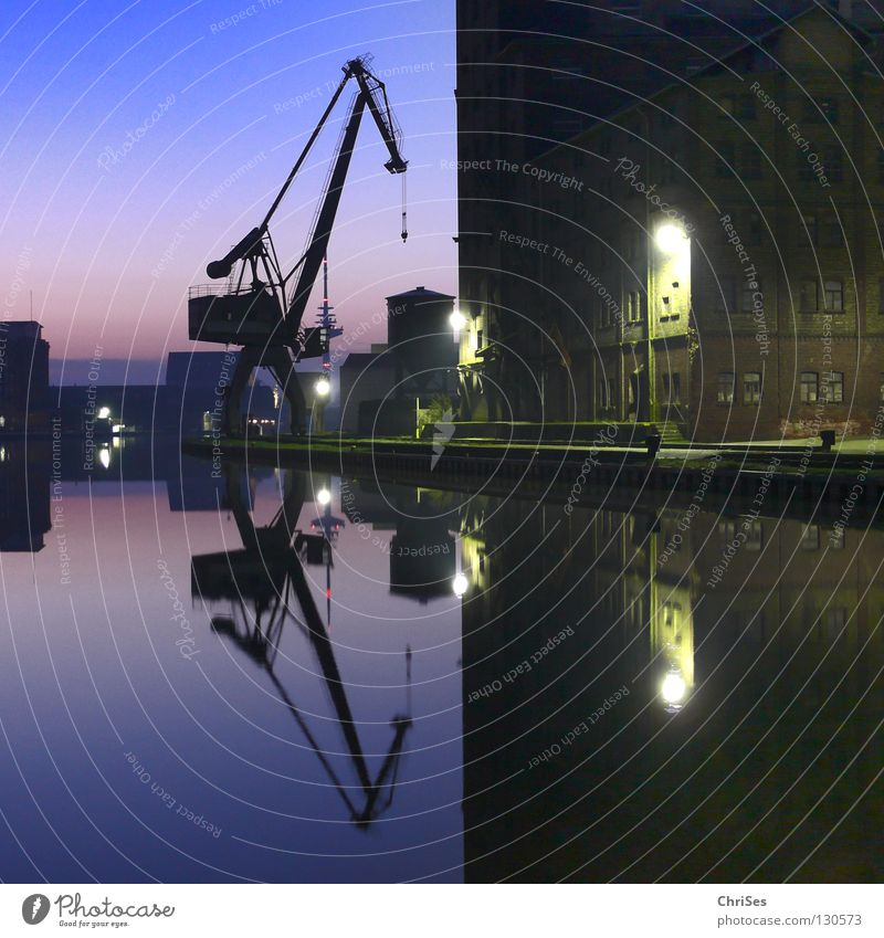 In the morning at 6.12 am at Kreativkai, Stadthafen1 Mirror Morning Sunrise Reflection Crane Construction crane Sky blue Symmetry Work and employment Light Calm