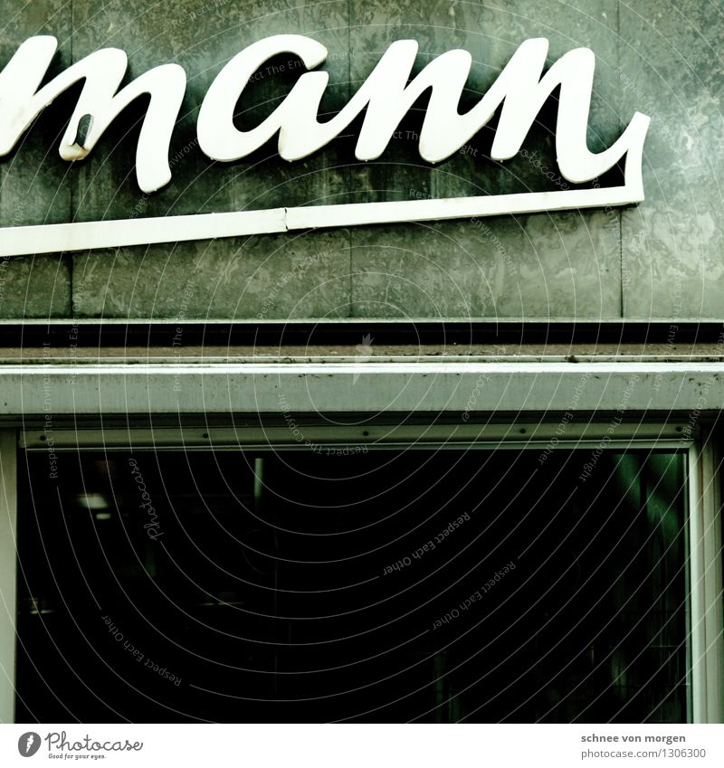 """man Cologne Town Downtown Wall (barrier) Wall (building) Facade Window Stone Old Authentic Exceptional Hip & trendy Black Silver Turquoise White """"Advertising"""