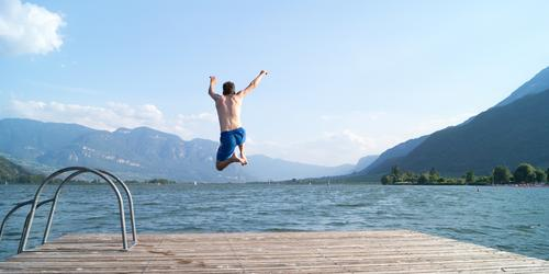 Human being Nature Vacation & Travel Youth (Young adults) Blue Summer Water Young man Landscape Joy Environment Warmth Swimming & Bathing Lake Jump Masculine