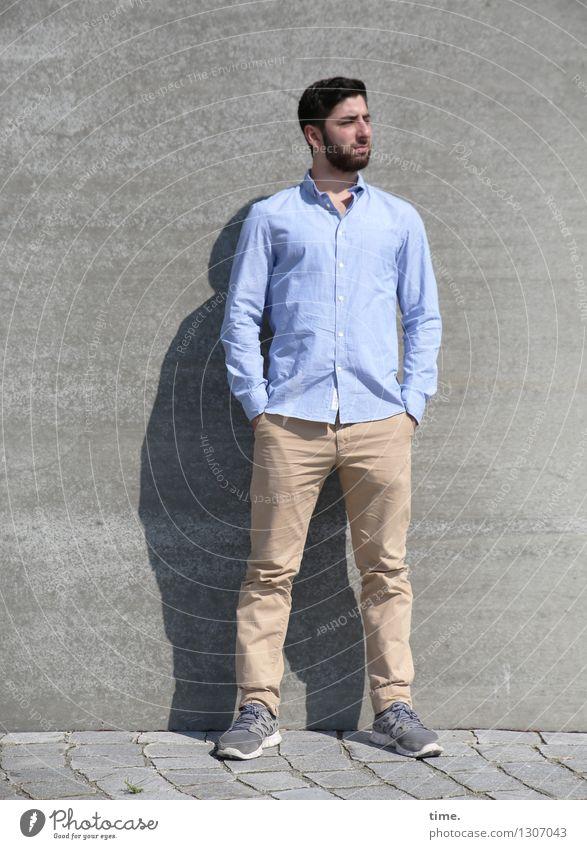 . Masculine Man Adults 1 Human being Wall (barrier) Wall (building) Street Lanes & trails Shirt Pants Footwear Brunette Short-haired Beard Observe Looking Stand