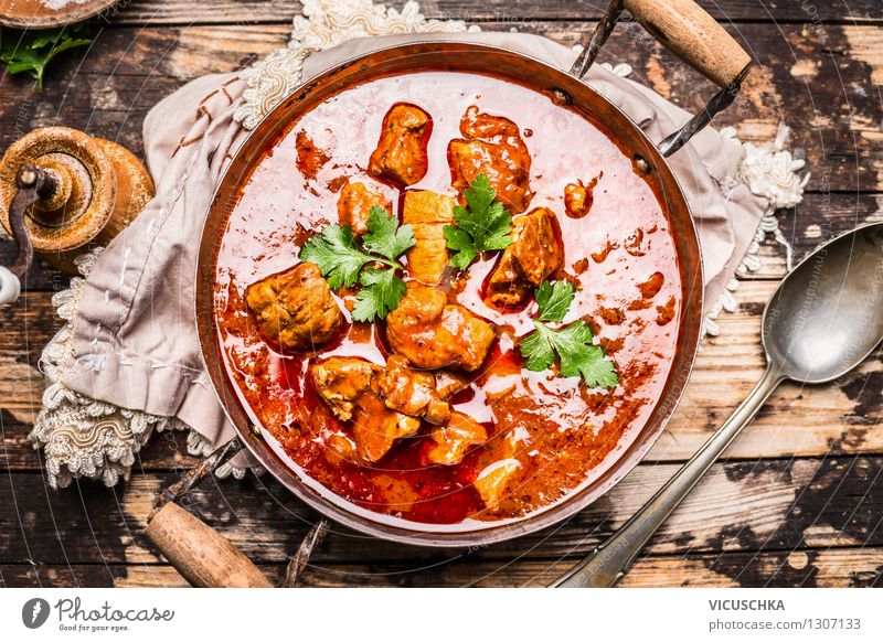 Delicious goulash in old pot with spoon Food Meat Vegetable Herbs and spices Nutrition Lunch Dinner Banquet Organic produce Pot Spoon Style Design