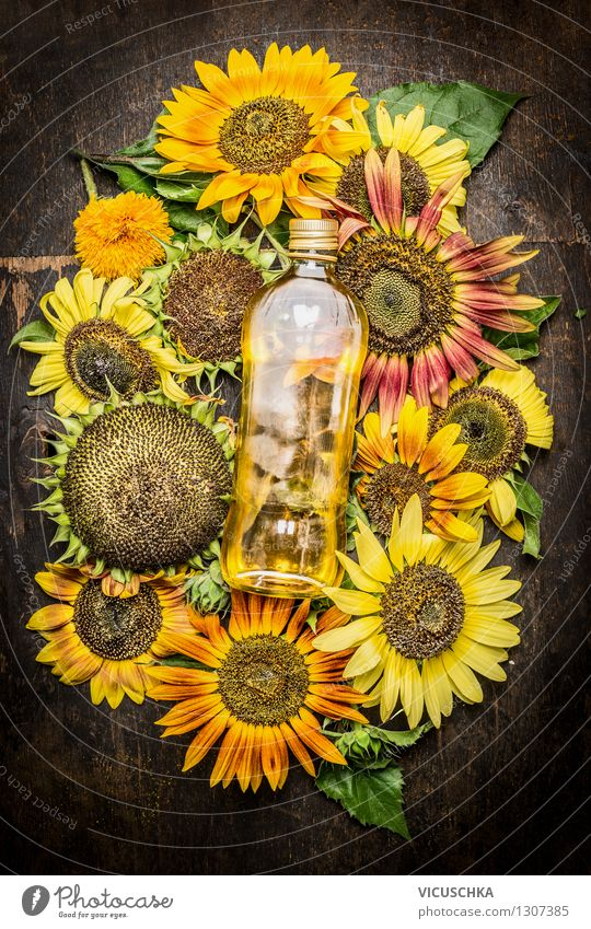 Sunflower oil with colourful sunflowers Food Cooking oil Nutrition Organic produce Vegetarian diet Diet Bottle Glass Summer Nature Flower Agricultural crop