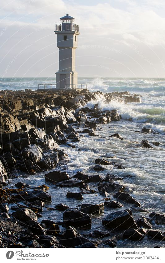 White lighthouse at the port of Akranes, Iceland Vacation & Travel Tourism Adventure Winter Wind Ocean Lighthouse coast acranes Atlantic Ocean waves birds gulls
