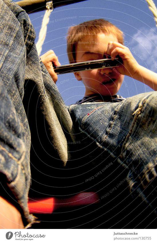 Child Sky Joy Boy (child) Playing Above Garden Freedom Jeans Upward Swing Playground Take a photo Grimace Snapshot