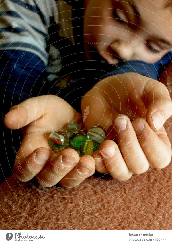 Child Hand Boy (child) Playing Think Glass Success Toys Sphere Concentrate Go under Roll Marble Glass ball