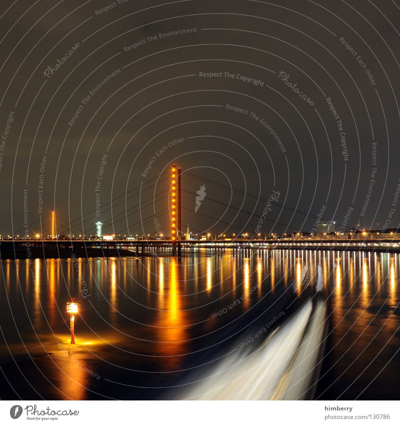 exhilarating sale II Town Lifestyle Night life Transmit Transmitting station Long exposure Exposure City life High-rise Column Bridge pier Duesseldorf Evening