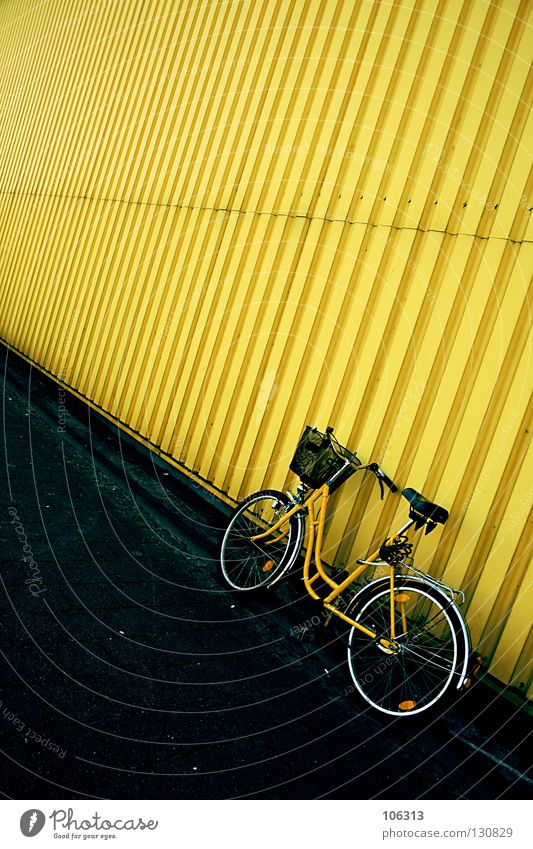 jaundice Yellow Stand Wall (building) Wall (barrier) Tin Corrugated sheet iron House (Residential Structure) Still Life Postman Bicycle Courier Ladies' bicycle
