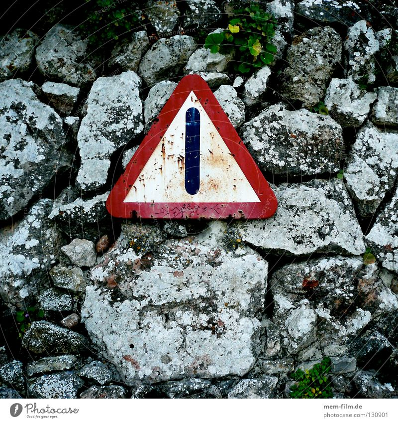 I'd be careful. Street sign Wall (barrier) Red Transport Caution Signs and labeling Rockfall Stone Old Rust