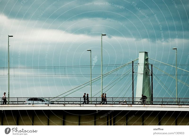 river crossing Pedestrian Work and employment Cologne Lantern Clouds Aspire Suspension bridge Bridge Human being Car Rhine Thunder and lightning Escape River