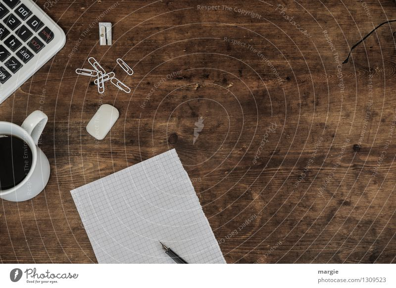 White paper, pen, paper clips, eraser, calculator and a cup of coffee on an old wooden desk Beverage Coffee Cup Desk Work and employment Profession Office work